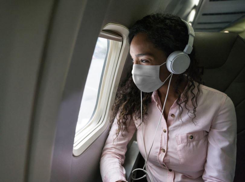 woman mask plane