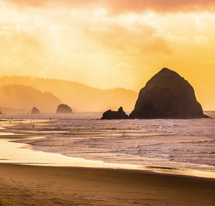 haystack rock ocean oregon sunset