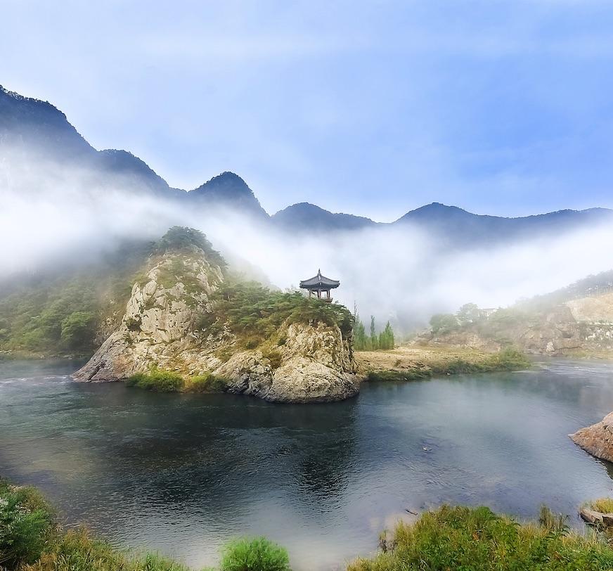Korea mountain building lake fog