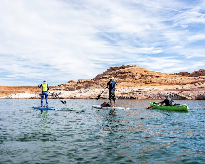 Lake Powell paddle boarding boats at canyons water