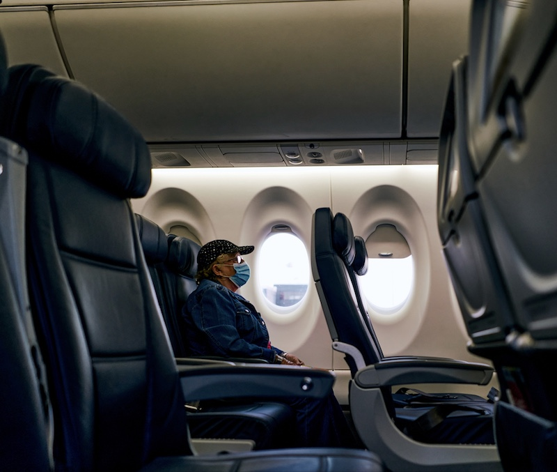 Senior on a plane during coronavirus pandemic