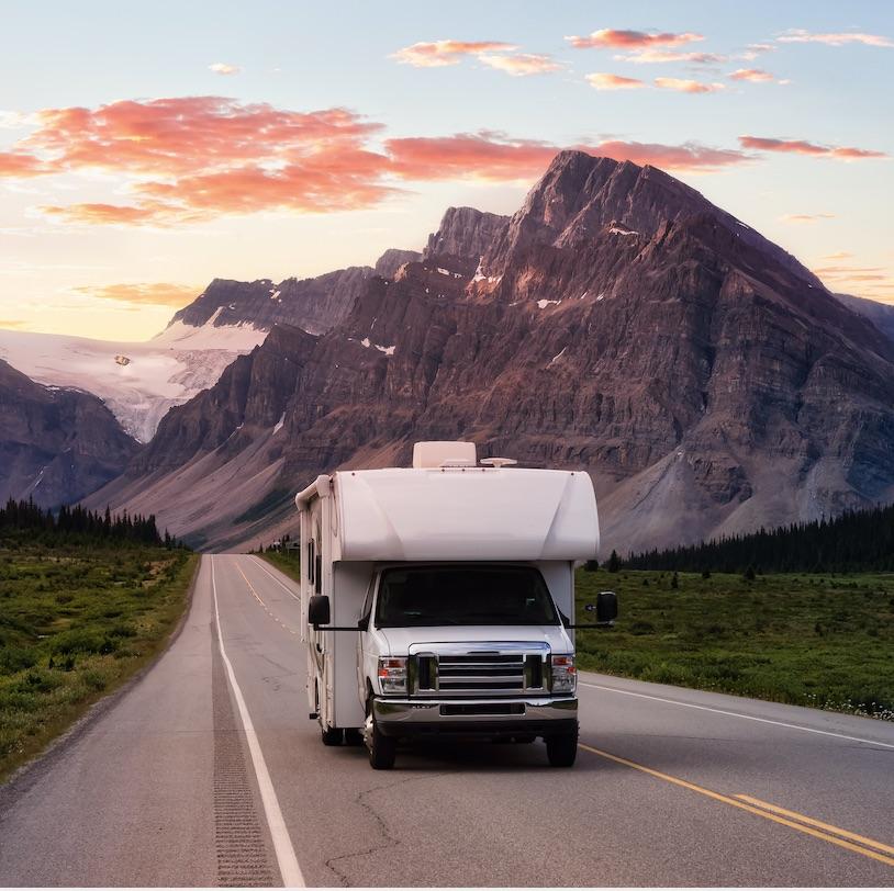camper van driving road mountains