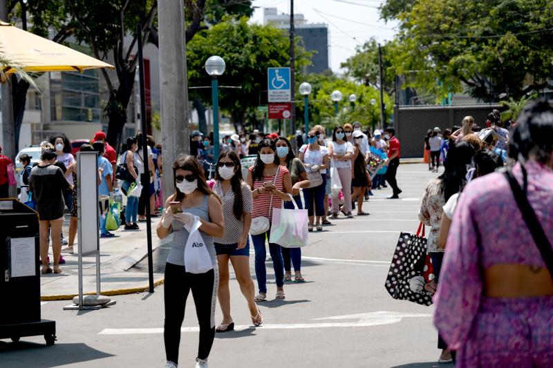 locals wearing masks in peru