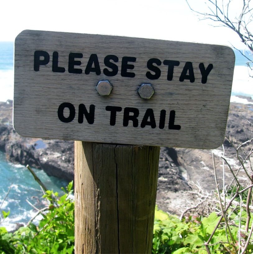 please stay on trail hiking sign