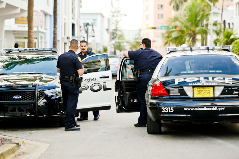 police men standing near car in miami beach