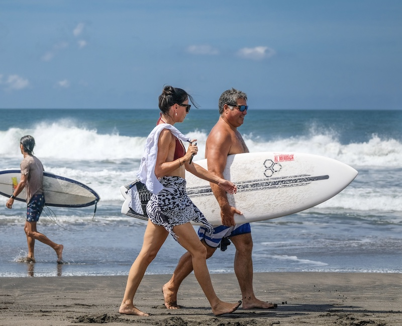 tourists surfing Bali beach