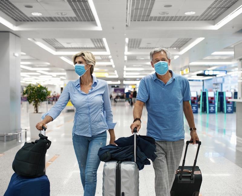 travelers arriving at airport masks