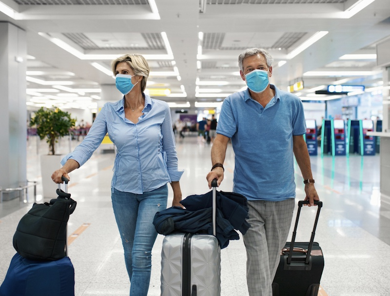 travelers face masks arriving at airport