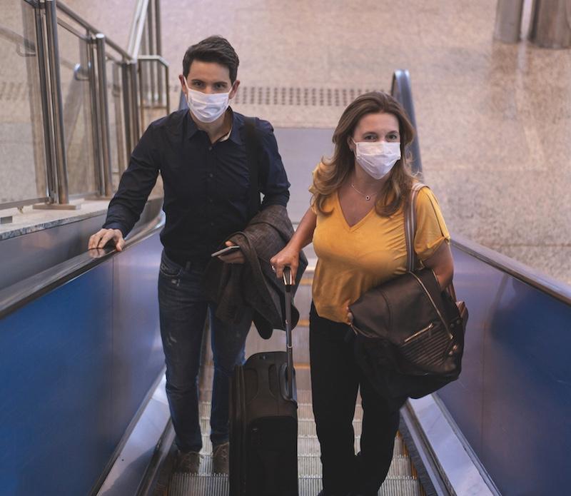 travelers mask airport