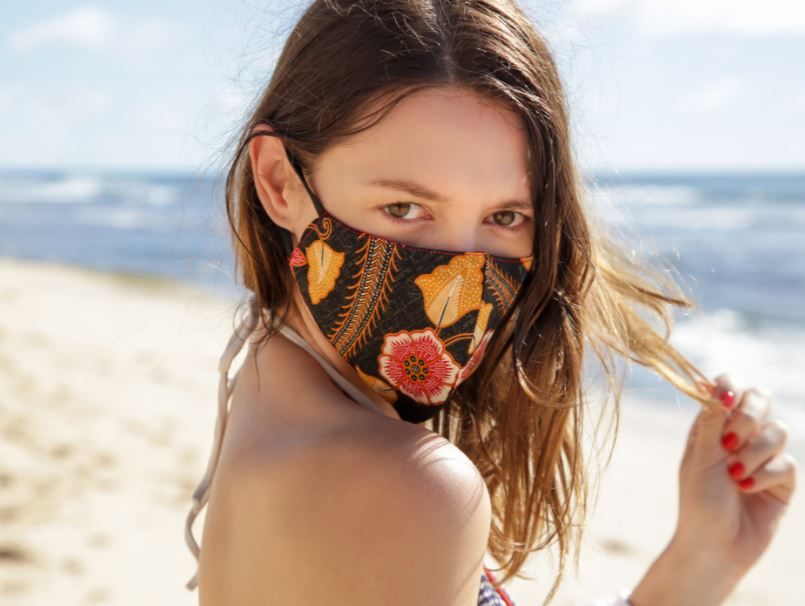woman mask beach