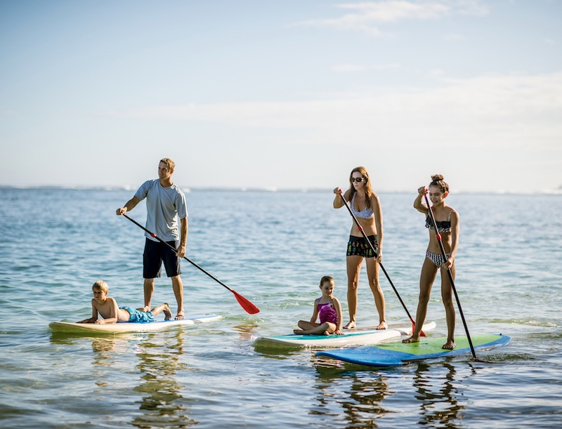 Stand up paddleboarding family Hawaii