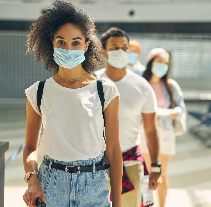 Traveler in Mask in line for vaccine