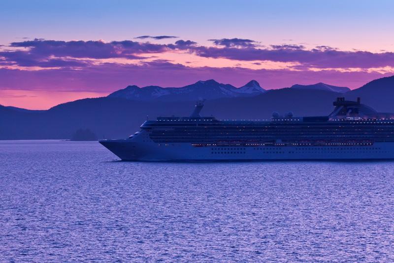 Cruise ship sailing along the Inside Passage in Alaska at sunset