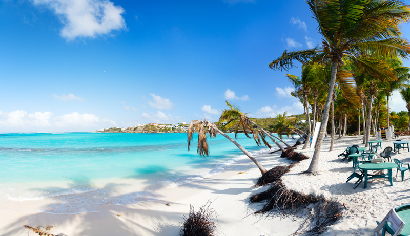 Beautiful beach framed with palms and seaside cafe on Caribbean island of Anguilla, 9 photos panorama