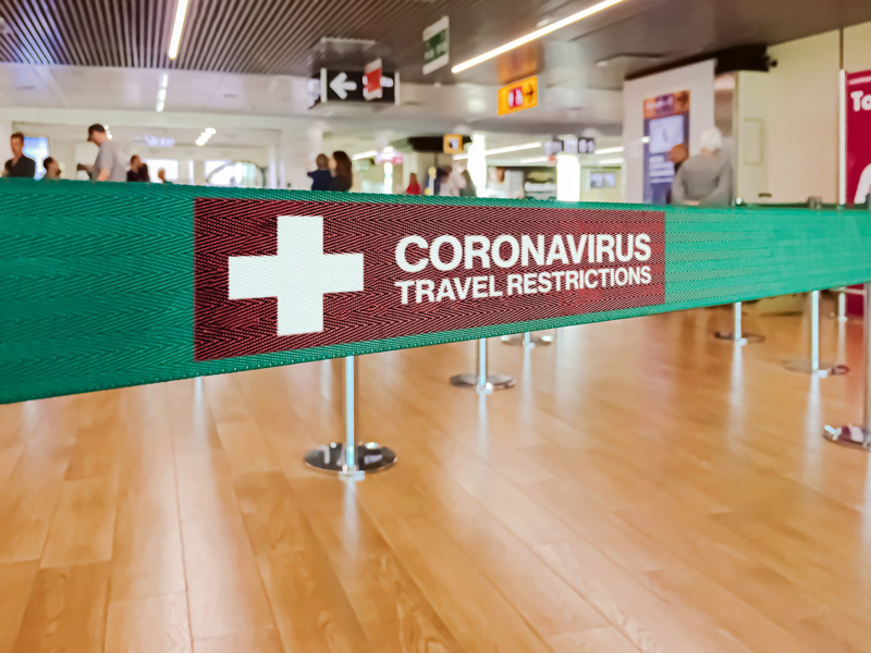 coronavirus travel restriction sign in airport