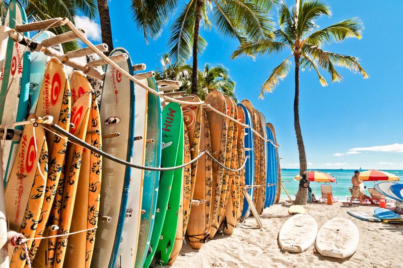 Surfboards lined up in the rack at Waikiki Beach in Honolulu. Oahu, Hawaii