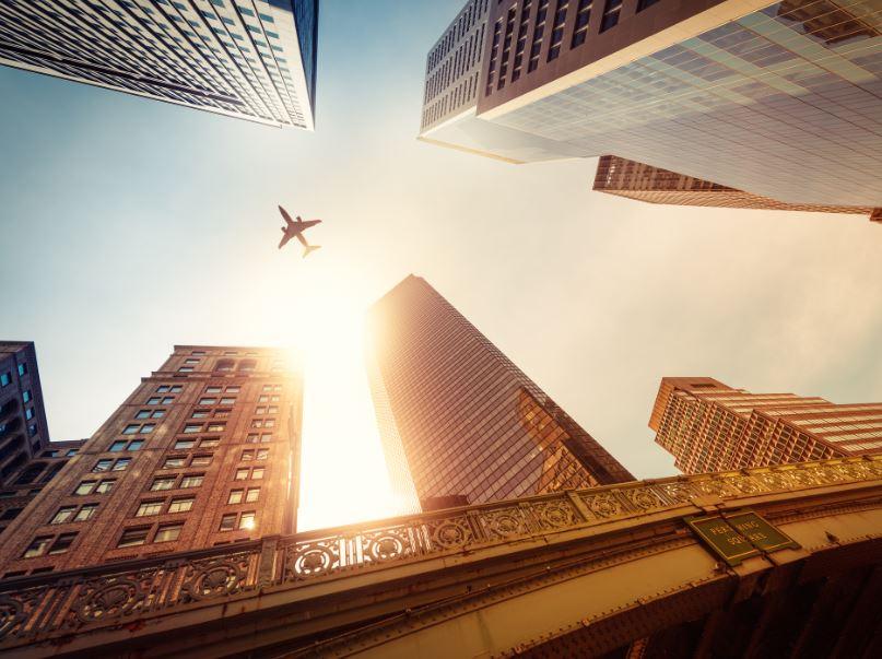 plane buildings skyscrapers hotels