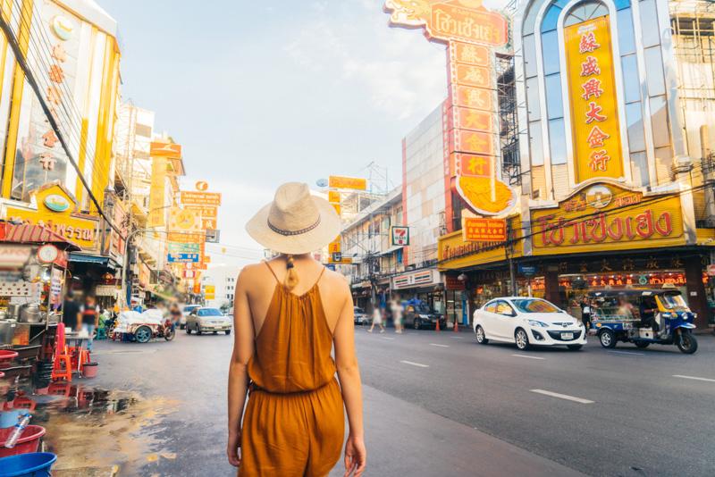 Young Caucasian Woman walking in Chianatown in Bangkok
