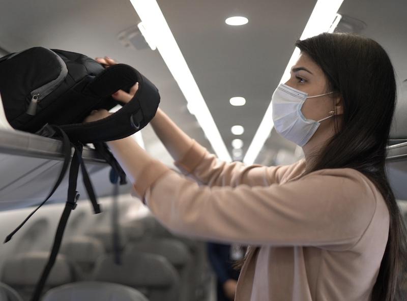 traveler boarding flight mask