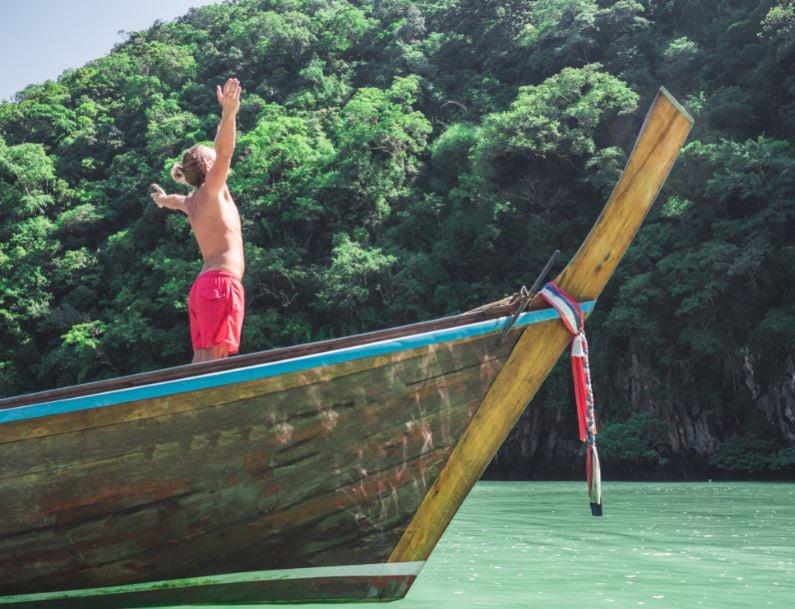 traveler long tail boat thailand