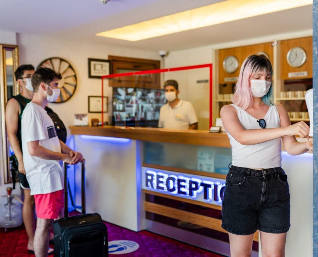 travelers wearing masks at hotels