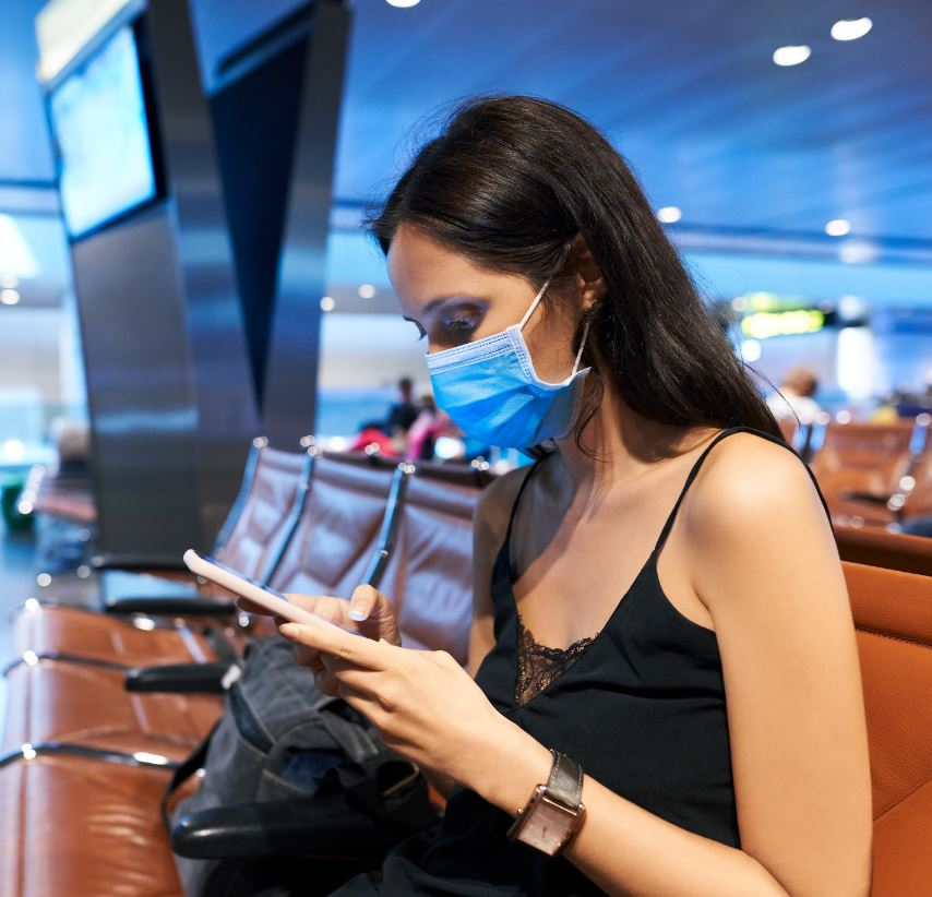 woman at airport in mask