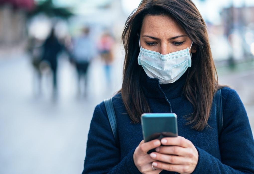 woman travel mask phone