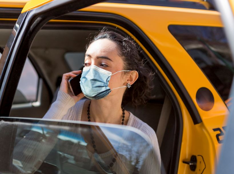 woman us taxi cab mask