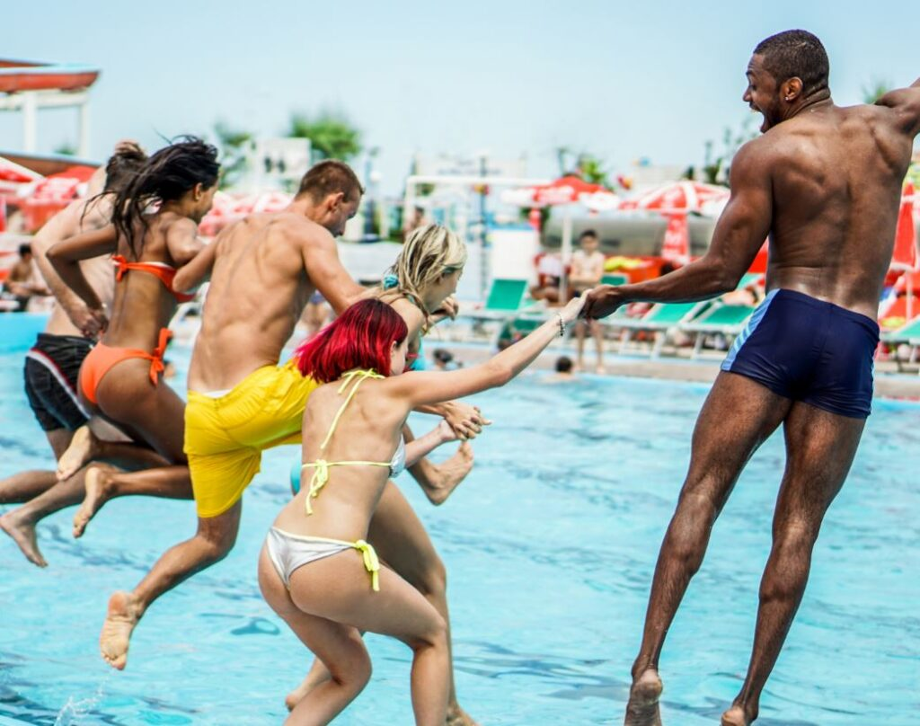Adults jump into the pool at Waterpark in Florida