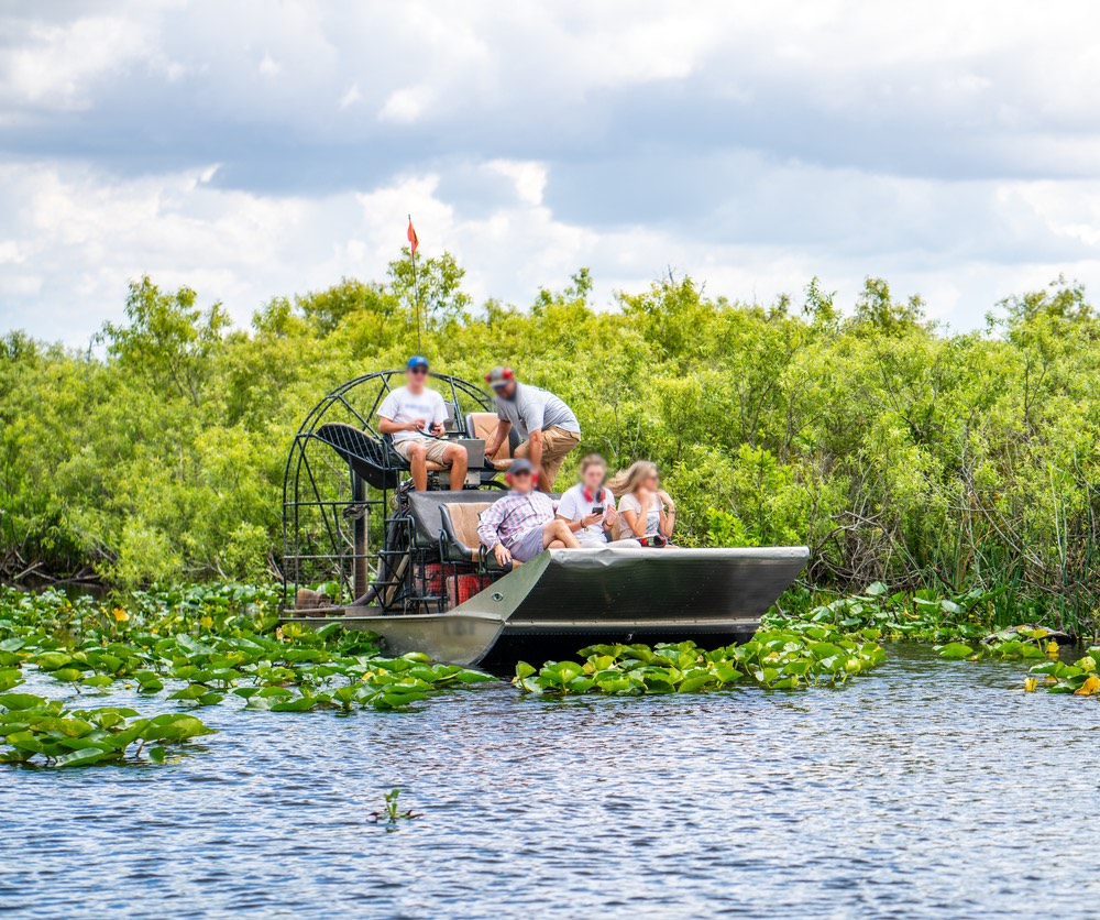Tourists in hovercraft at Everglades National Park