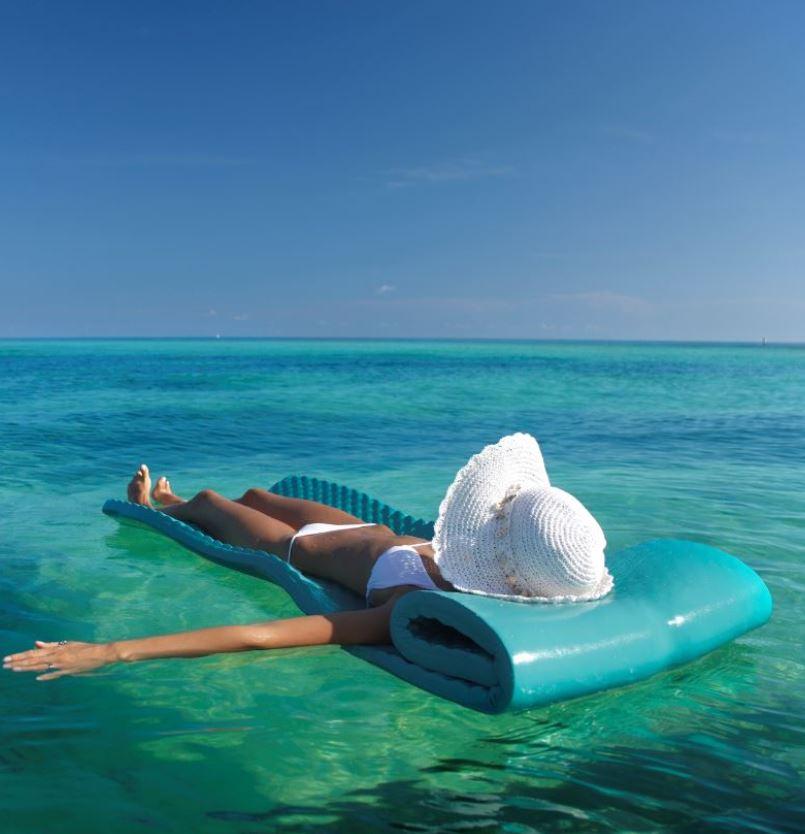 Woman in Florida relaxing on ocean