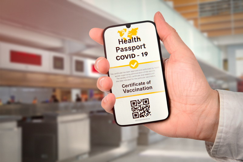 Covid-19 Certificate of Vaccination app on mobile phone at the airport