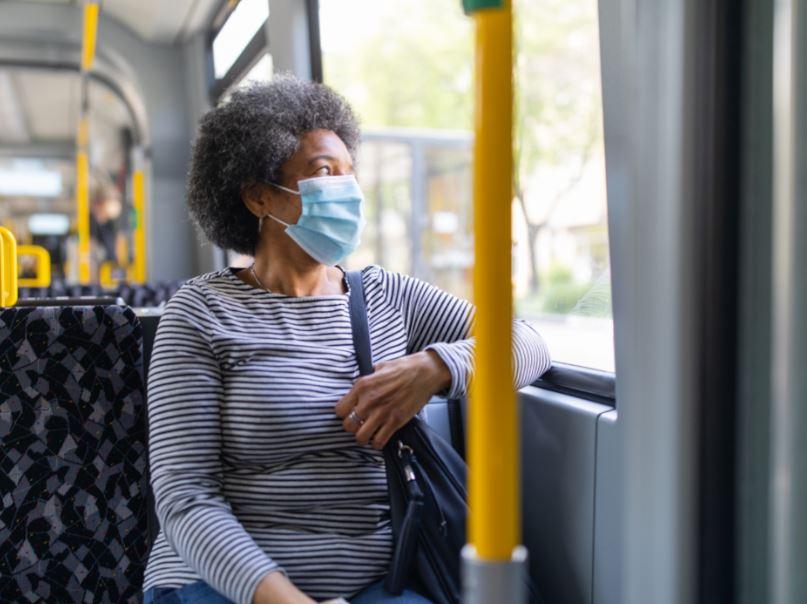 woman mask bus
