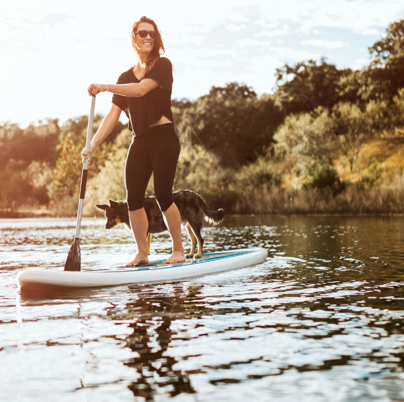 SUP woman and dog on water