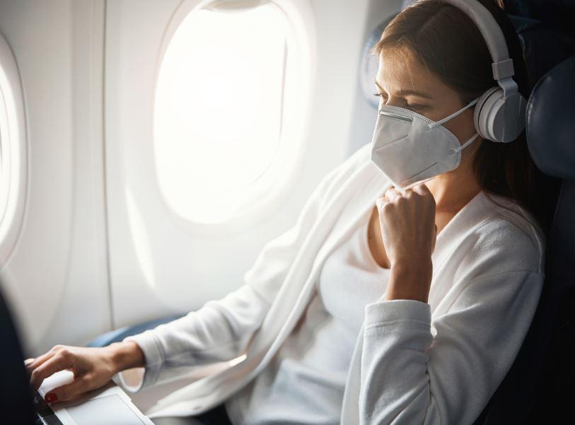 female passenger mask laptop woman