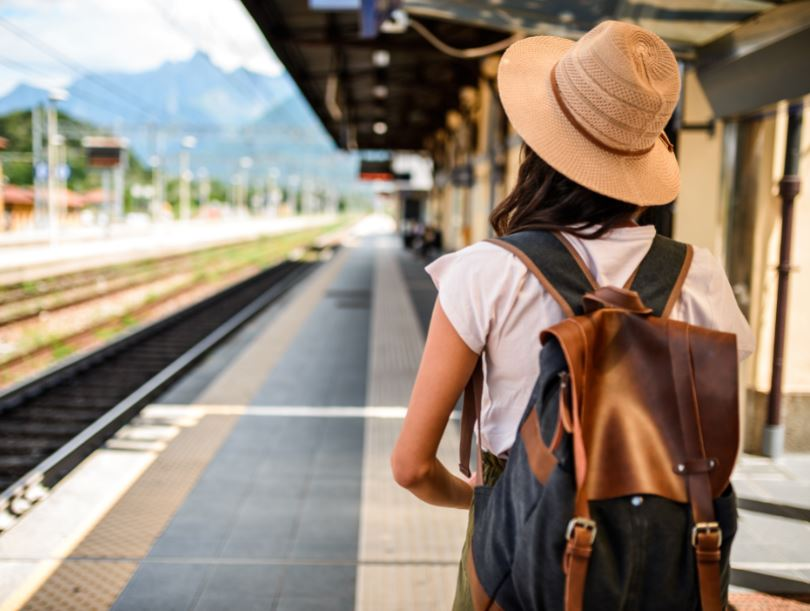 female traveler woman train station
