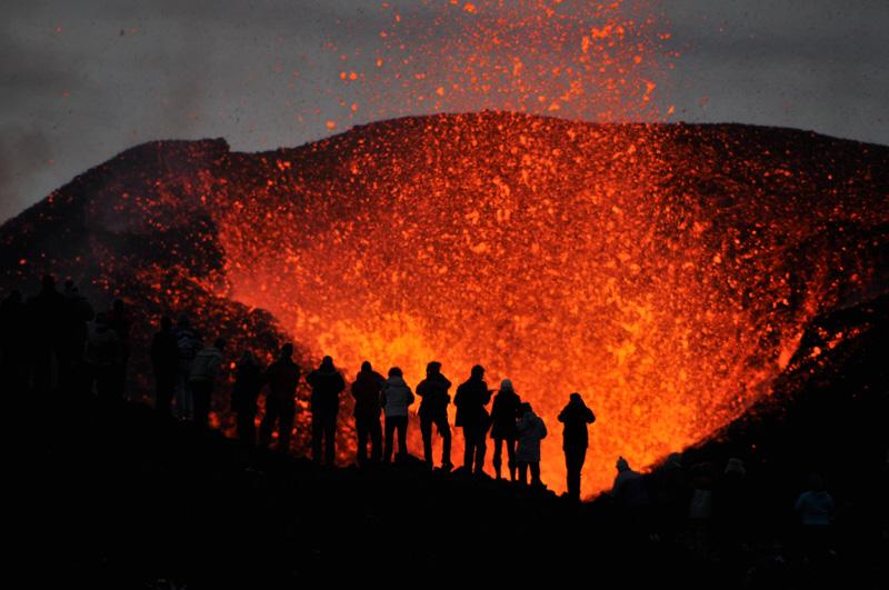 group of adventurers witnessing the eruption of volcano Eyjafjallajökull