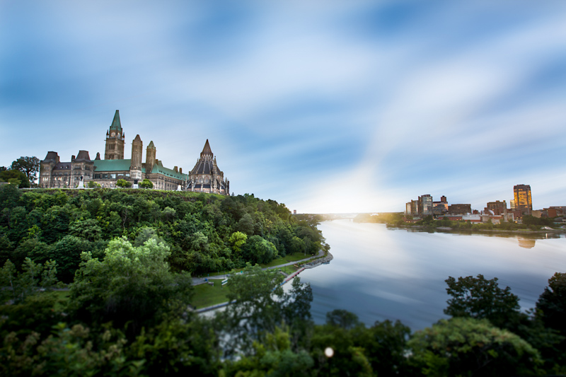 A landscape of Parliament Hill, Ottawa and Gatineau, Quebec, separated by the Ottawa River.