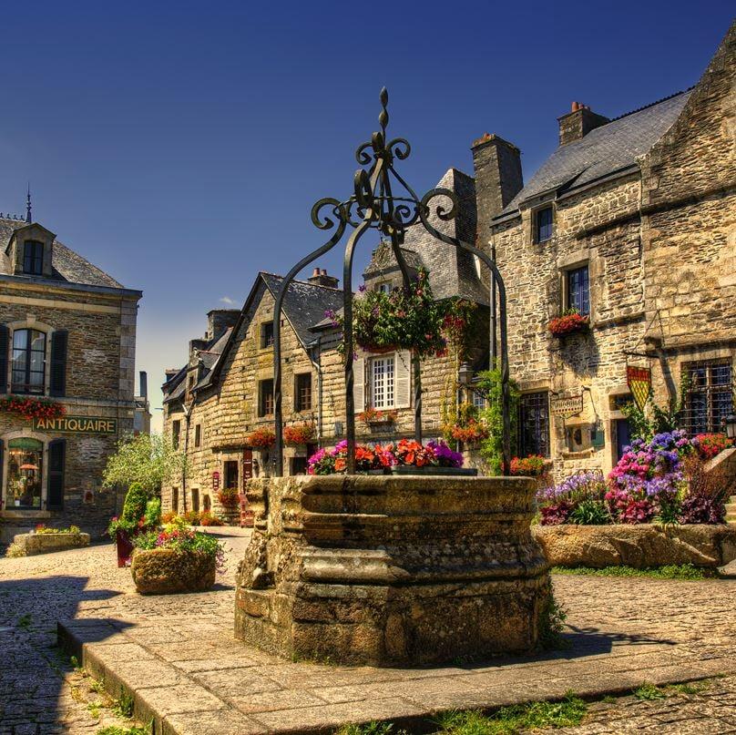 Village square in sunshine, Brittany France summertime