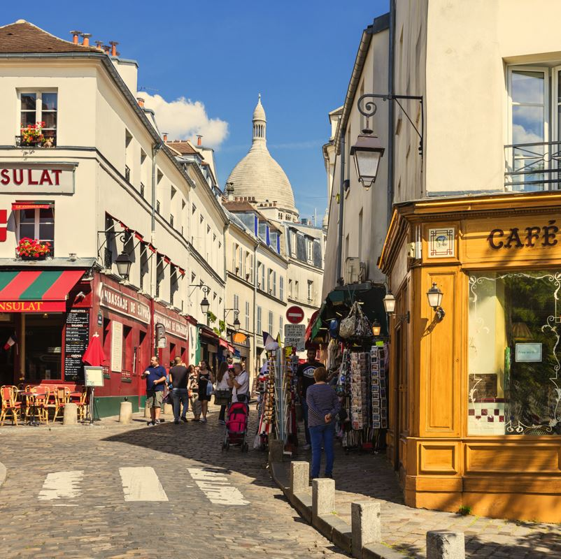 pavement cafes and street in Montmartre Paris
