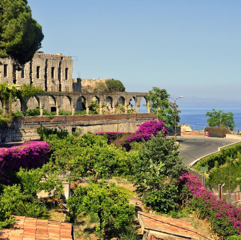 Taormina ruins, flowers and sea