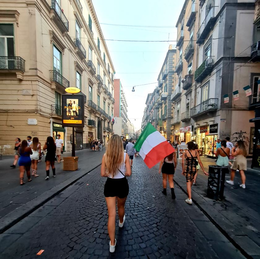 Walking on Italy streets with flag