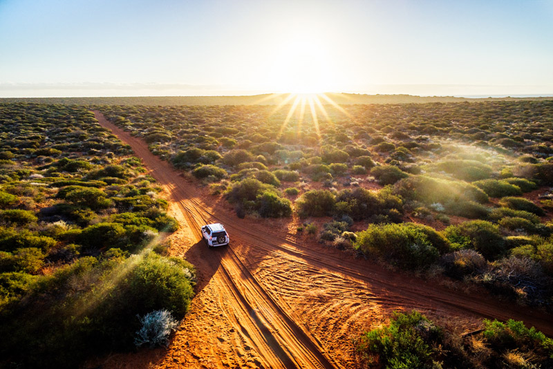 Driving off-road in Western Australia at sunset