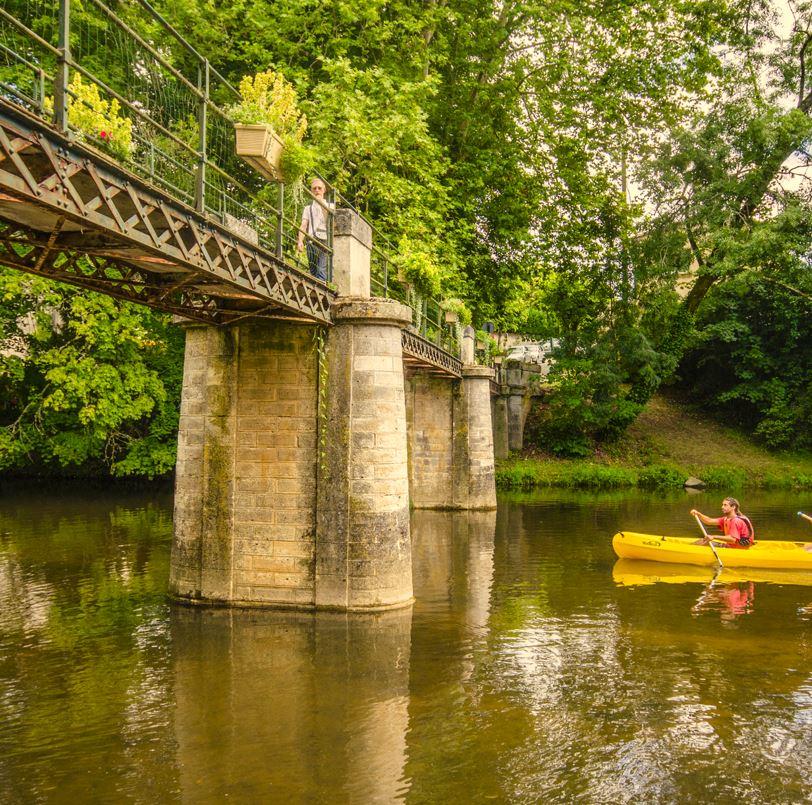 canoe on river with bridge