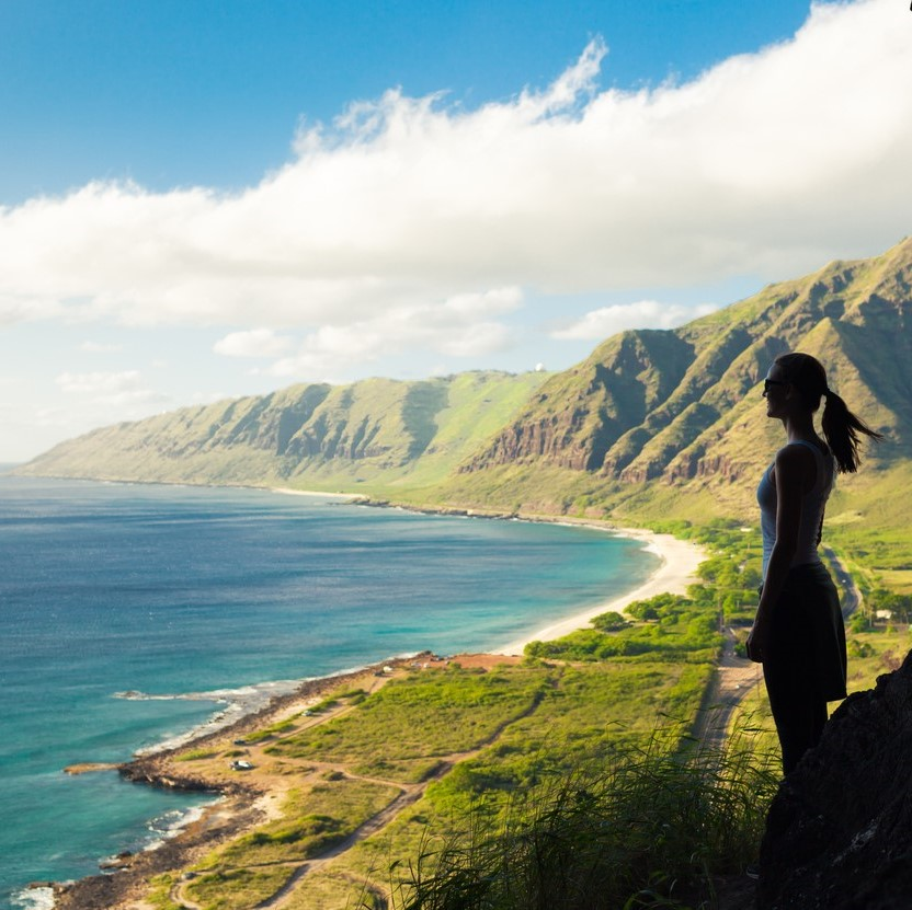 Young woman looking out at the beautiful ocean view.
