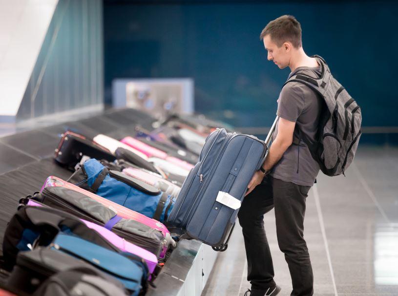 man collecting luggage