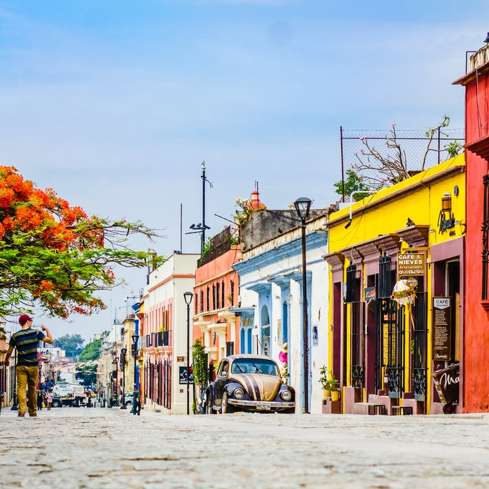 View on street with Colorful colonial buildings in the old town with a group of people