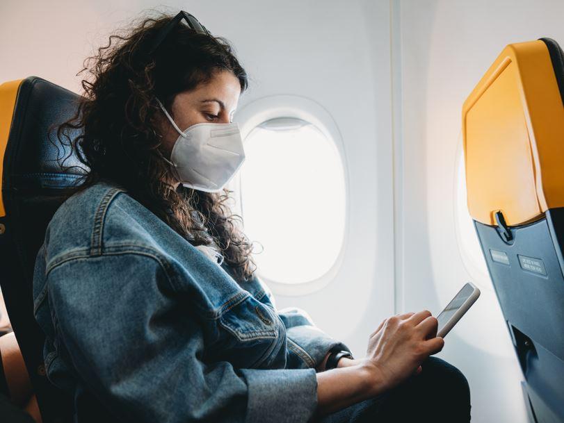 woman mask airline passenger