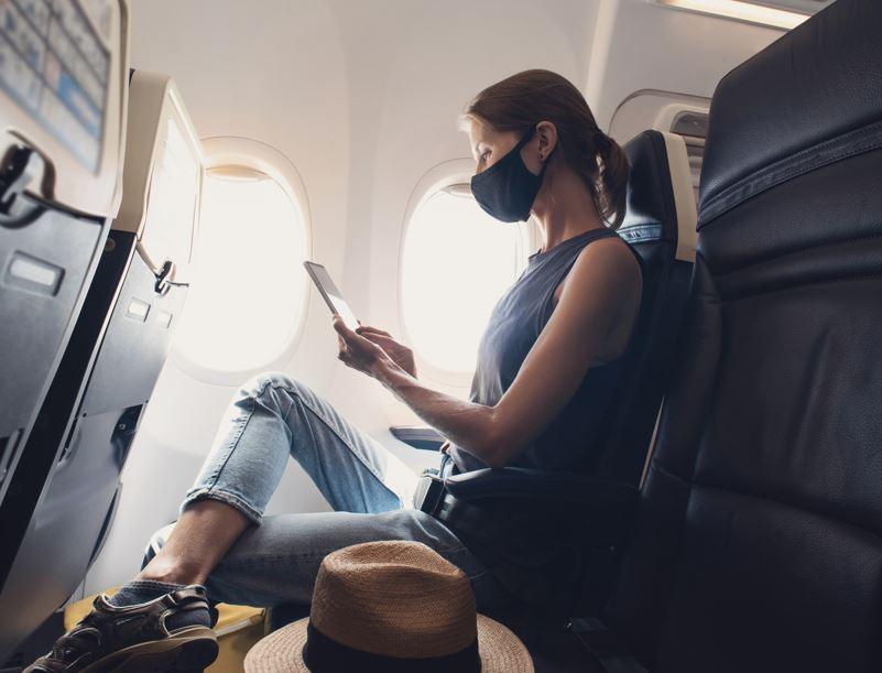 woman mask passenger airline