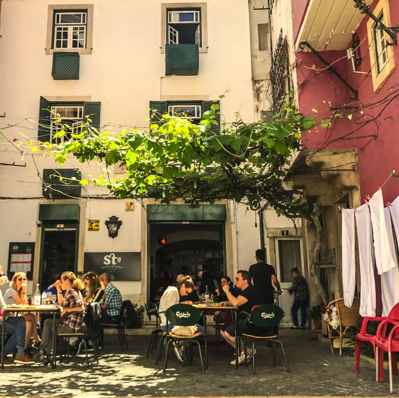 Alfama lisbon cafe and washing in street